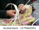 hand of emirati woman is... | Shutterstock . vector #1179860341