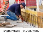 bricklayer at work in a... | Shutterstock . vector #1179874087