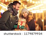 adult couple shopping in the... | Shutterstock . vector #1179879934