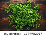 sweet raw green pea shoots on... | Shutterstock . vector #1179902017