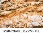 dark old stone wall background... | Shutterstock . vector #1179928111