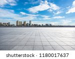 empty square with city skyline... | Shutterstock . vector #1180017637