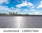 empty square with city skyline... | Shutterstock . vector #1180017664