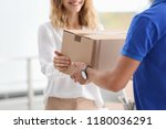 young woman receiving parcel... | Shutterstock . vector #1180036291