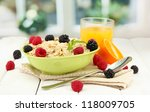 tasty oatmeal with berries and... | Shutterstock . vector #118009705