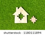 house made of wooden puzzles... | Shutterstock . vector #1180111894