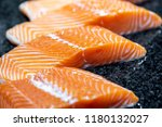 raw salmon fish fillet on black ... | Shutterstock . vector #1180132027