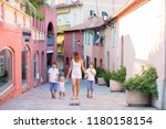 young mother  holding her... | Shutterstock . vector #1180158154