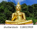 The big golden Buddha statue on hill, Phuket, Thailand - stock photo