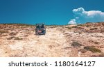 buggy on sandy road riding up...   Shutterstock . vector #1180164127