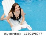 enjoying holiday in the pool.... | Shutterstock . vector #1180198747