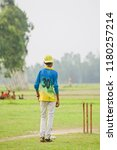 a young umpire of a cricket... | Shutterstock . vector #1180257214