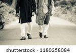 two young men walking in the... | Shutterstock . vector #1180258084
