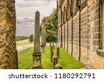 a row of miniature obelisks in... | Shutterstock . vector #1180292791