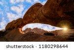 ancient granite rock forming a... | Shutterstock . vector #1180298644