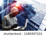 hacker man steal information | Shutterstock . vector #1180307101