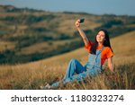 woman taking a selfie in nature ... | Shutterstock . vector #1180323274