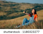 woman taking a selfie in nature ... | Shutterstock . vector #1180323277