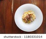 spaghetti carbonara in white... | Shutterstock . vector #1180331014