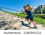 rear view of young boy running... | Shutterstock . vector #1180341121