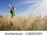 happy young girl raising her... | Shutterstock . vector #118037659