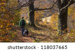 a girl walking with her dog in... | Shutterstock . vector #118037665