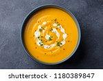 pumpkin  carrot cream soup in a ...   Shutterstock . vector #1180389847
