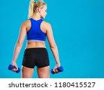 sporty woman lifting light... | Shutterstock . vector #1180415527