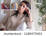 sad and thoughtful woman at home | Shutterstock . vector #1180475401