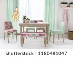 dining table with curtains and... | Shutterstock . vector #1180481047