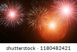 colorful firework background. | Shutterstock . vector #1180482421