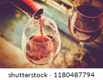 wine is poured into glass. wine ... | Shutterstock . vector #1180487794