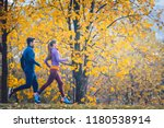 woman and man jogging or... | Shutterstock . vector #1180538914