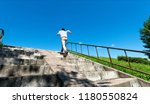 rear view of young man running... | Shutterstock . vector #1180550824