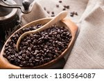 fresh coffee beans. dry roasted ... | Shutterstock . vector #1180564087