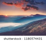 Small photo of Amazing landscape in the mountains at sunrise. View of foggy hills covered by forest. Concept of the awakening wildlife, romance,emotional experience in your soul, joy in mundane life.