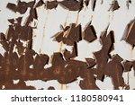 white paint peeling on old... | Shutterstock . vector #1180580941