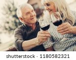 cheers. focus on mature couple... | Shutterstock . vector #1180582321