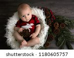 little baby boy with christmas... | Shutterstock . vector #1180605757