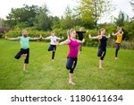 yoga in nature does exercise on ... | Shutterstock . vector #1180611634