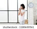 asian women drink coffee after...   Shutterstock . vector #1180630561