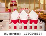 three red paper cups on the... | Shutterstock . vector #1180648834