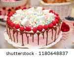 raspberry cupcake on the party... | Shutterstock . vector #1180648837