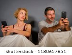 young attractive couple using...   Shutterstock . vector #1180657651