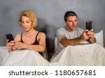 young attractive couple using...   Shutterstock . vector #1180657681