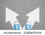 teenager in blue shoes standing ... | Shutterstock . vector #1180695454
