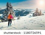 ski touring in high alpine...   Shutterstock . vector #1180726591