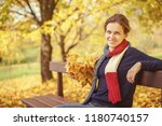 young beautiful woman in autumn ... | Shutterstock . vector #1180740157