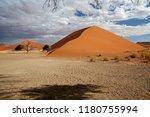 sand dunes in the salt pan of... | Shutterstock . vector #1180755994
