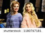 women buy furry coats. friends...   Shutterstock . vector #1180767181